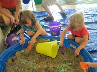 two girls in the sandbox