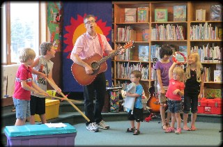 Children singing with Kevin Devine